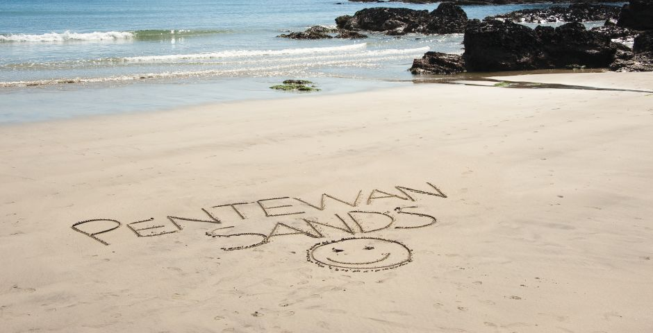 Writing on the sand at Pentewan Sands Holiday Park