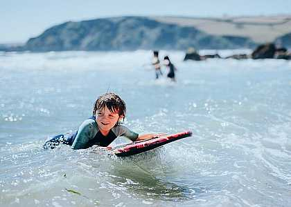 Boy surfing at Pentewan